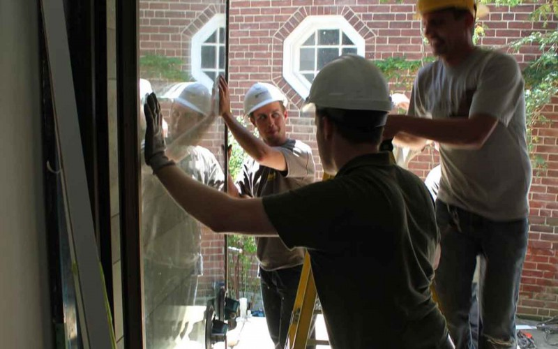 Explore1 Service Men Install Massive Jumbo Glass Residential Door
