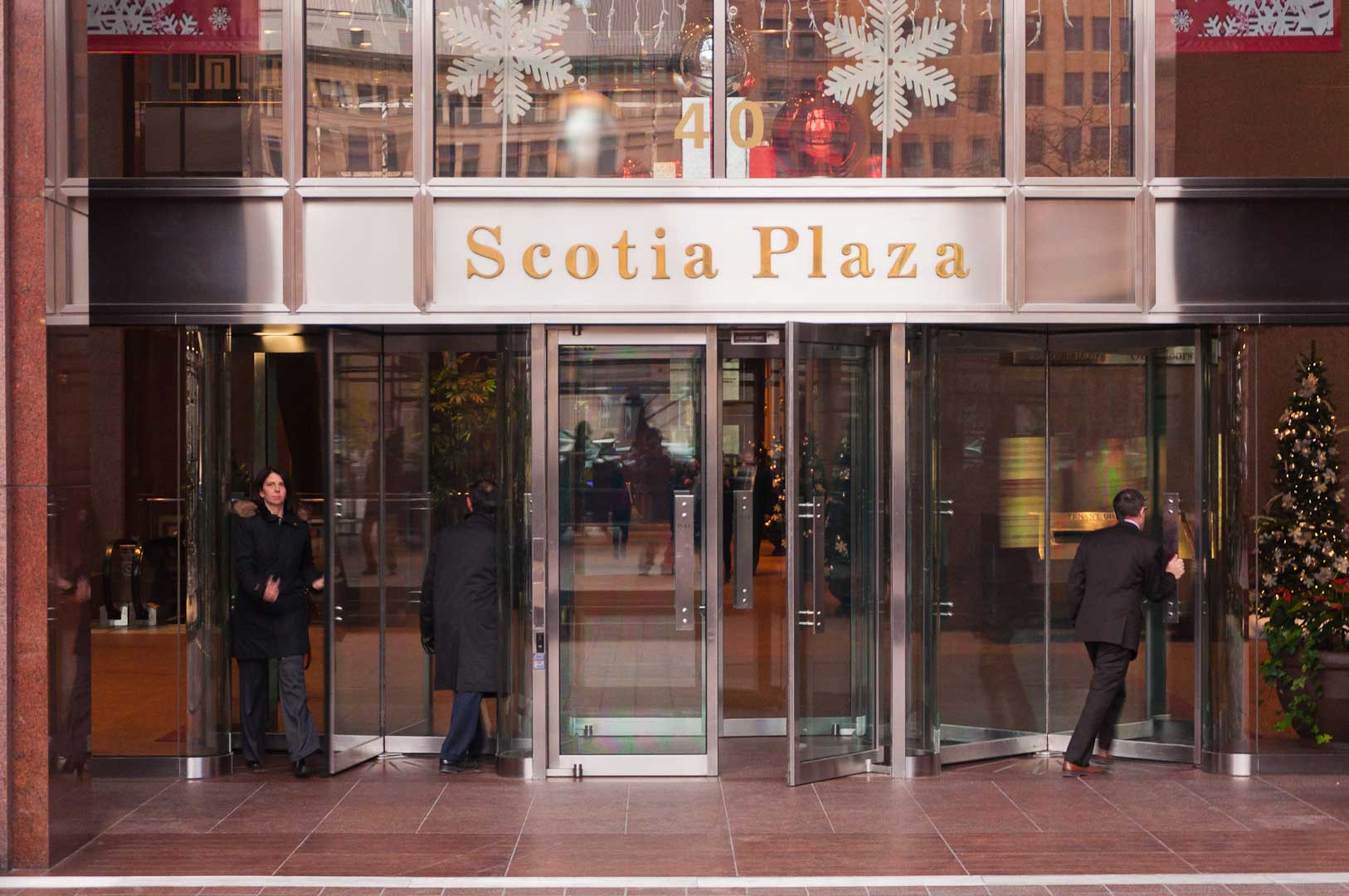 People going through the Revolving Doors at the Scotia Plaza in Toronto maintained by Explore1