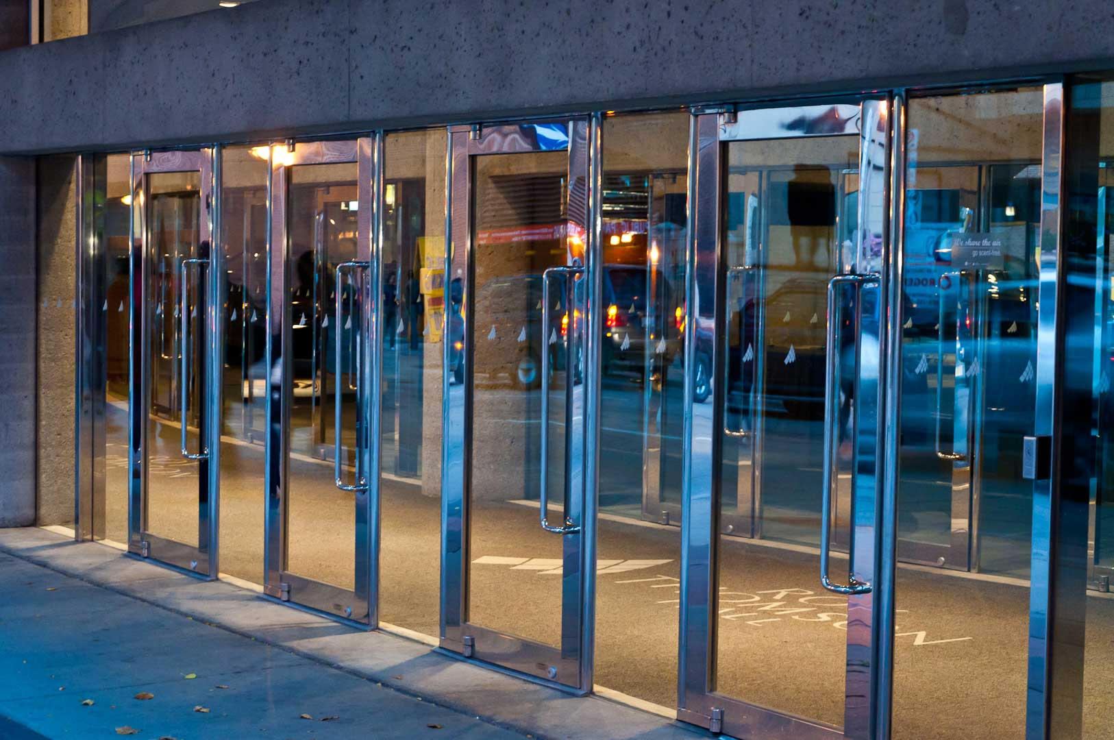 RH view of Bank of Glass and Stainless steel Balanced Doors in Toronto Maintained by Explore1.ca