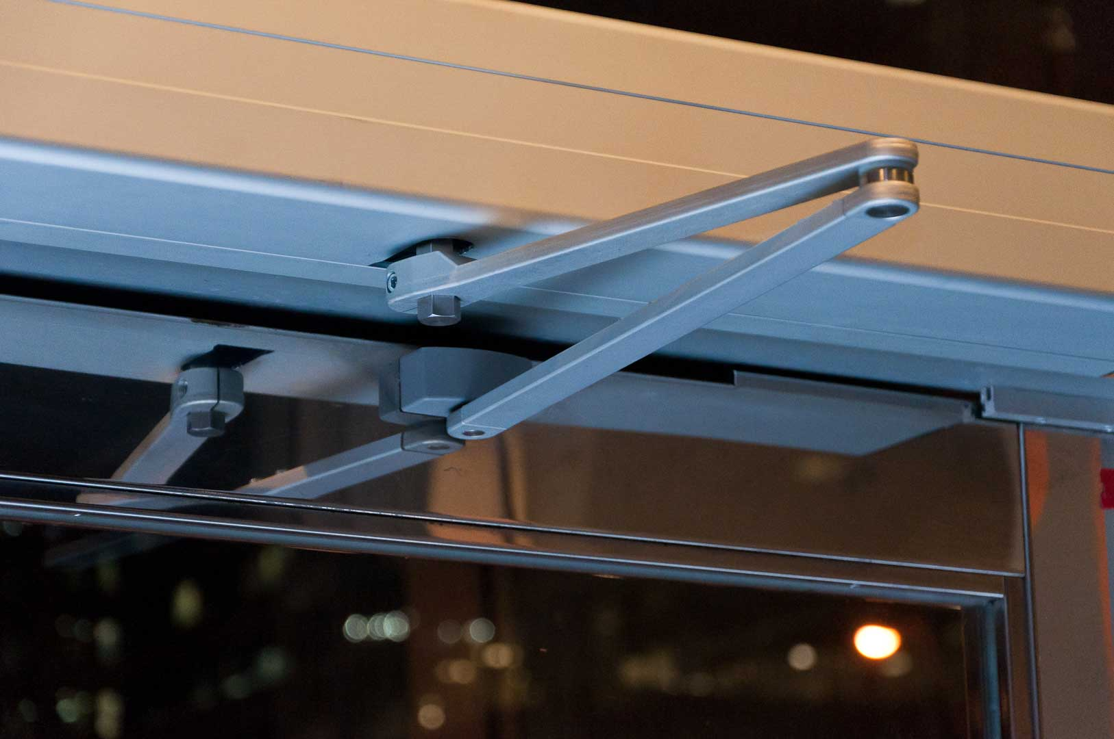 Close up of swing arm on a iMotion 1301 Automatic Door operator installed in Toronto by Explore1.ca