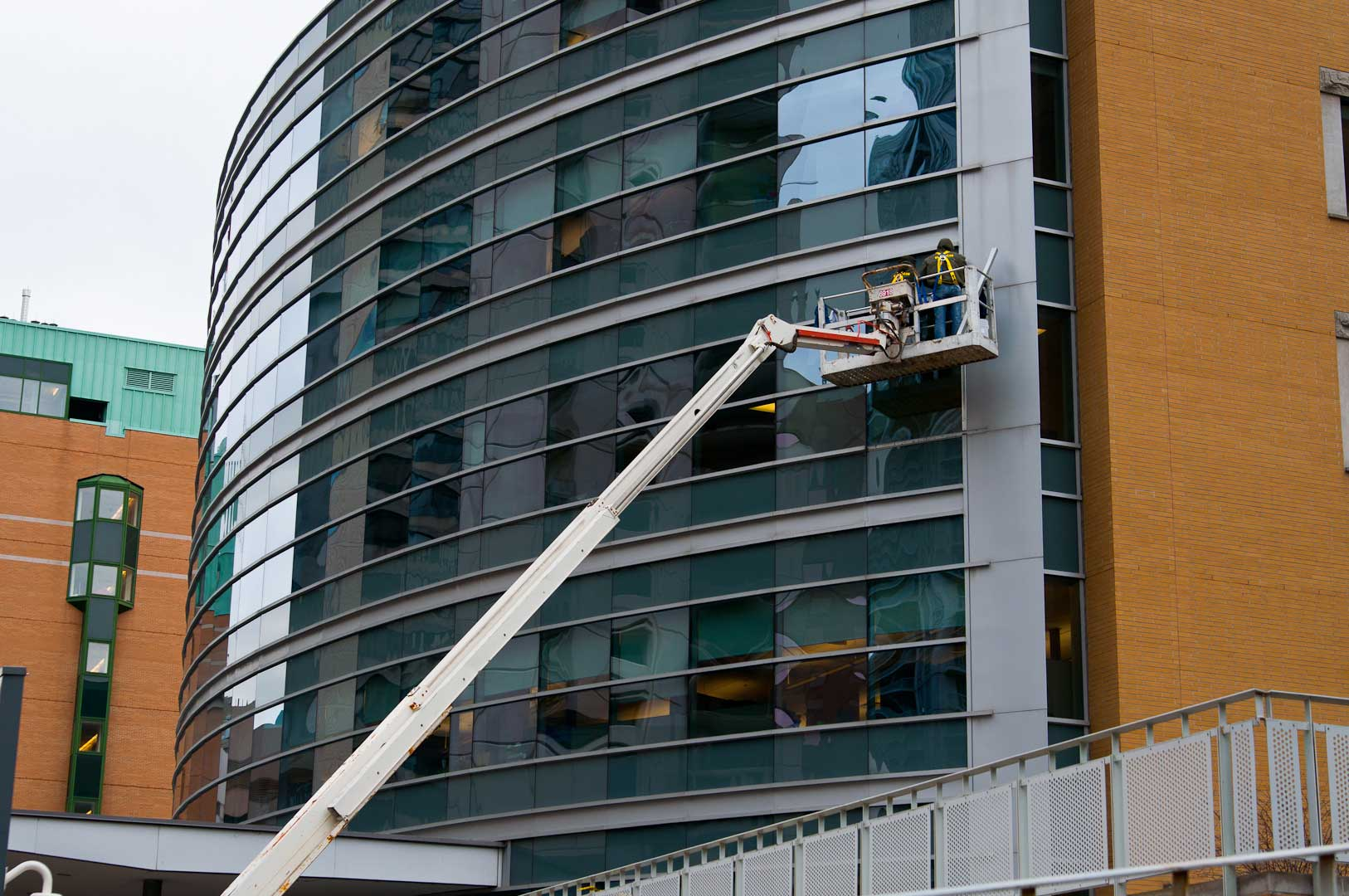 Telescoping Boom Truck Used to Access Building Facade in Toronto by Explore1