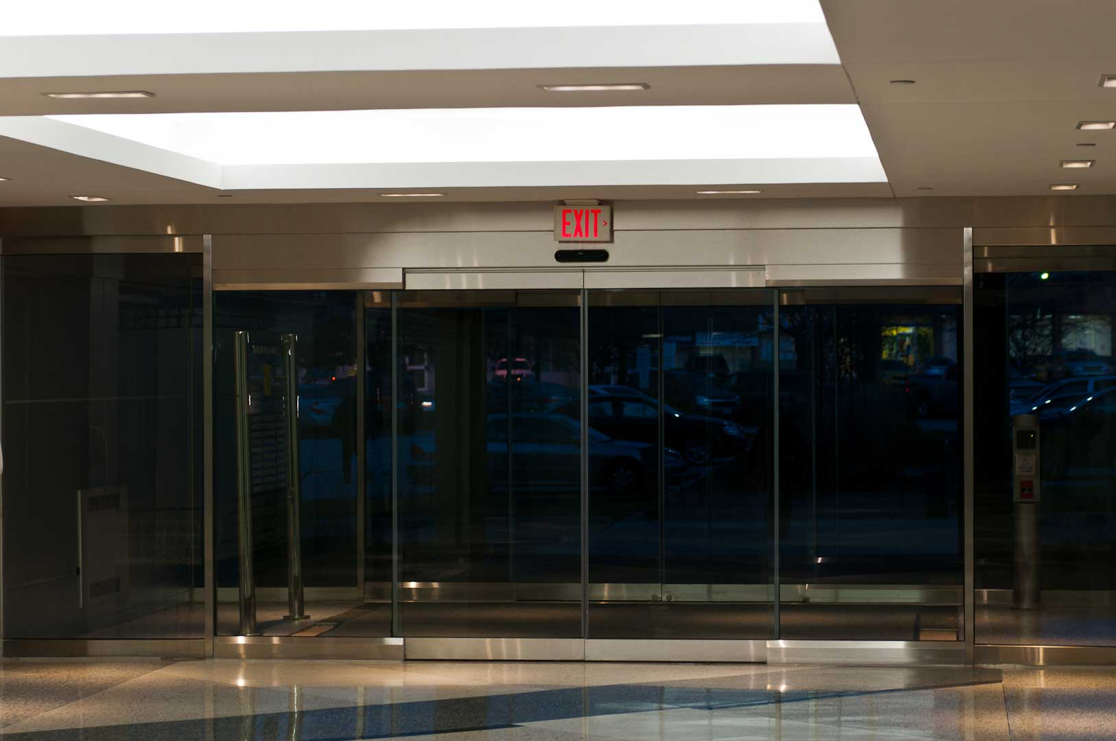 All glass building entrance installed by Explore1.ca in Toronto that features a Tormax Sliding door system