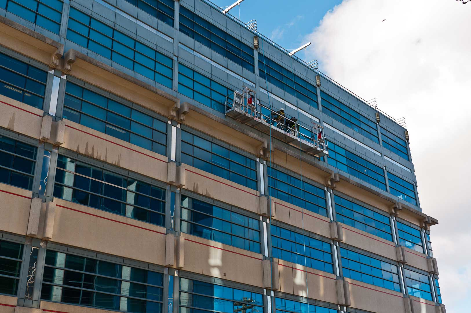 Building Facade Maintenance by High-Rise Experts Explore1.ca with Proper Safety Harnesses