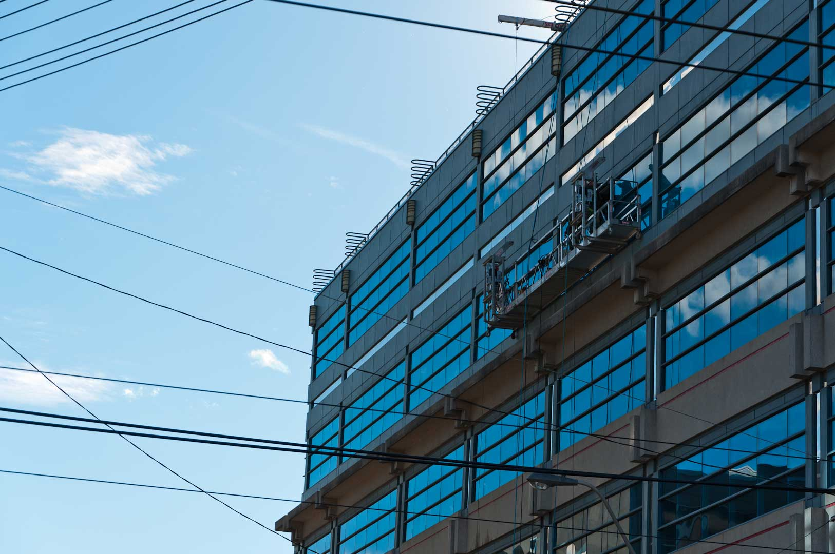 High-Rise Facade Work by Explore1.ca Showing Mirror Glass Exterior