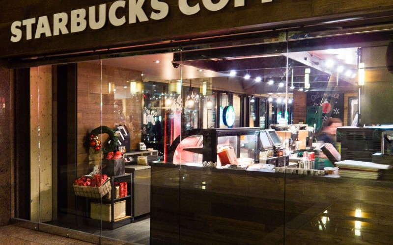 Starbucks Coffee Located at 1 Queen St E. Toronto Glass Storefront built by Explore1.ca