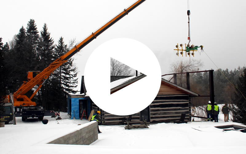 Explore1's Suction Cup Counterbalance lifter on the end of a crane installing massive windows in a luxury home