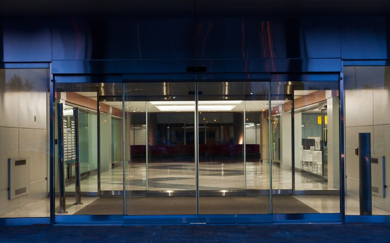 Night time view of Tormax TX9500 All Glass Sliding Doors Installed by Explore1.ca