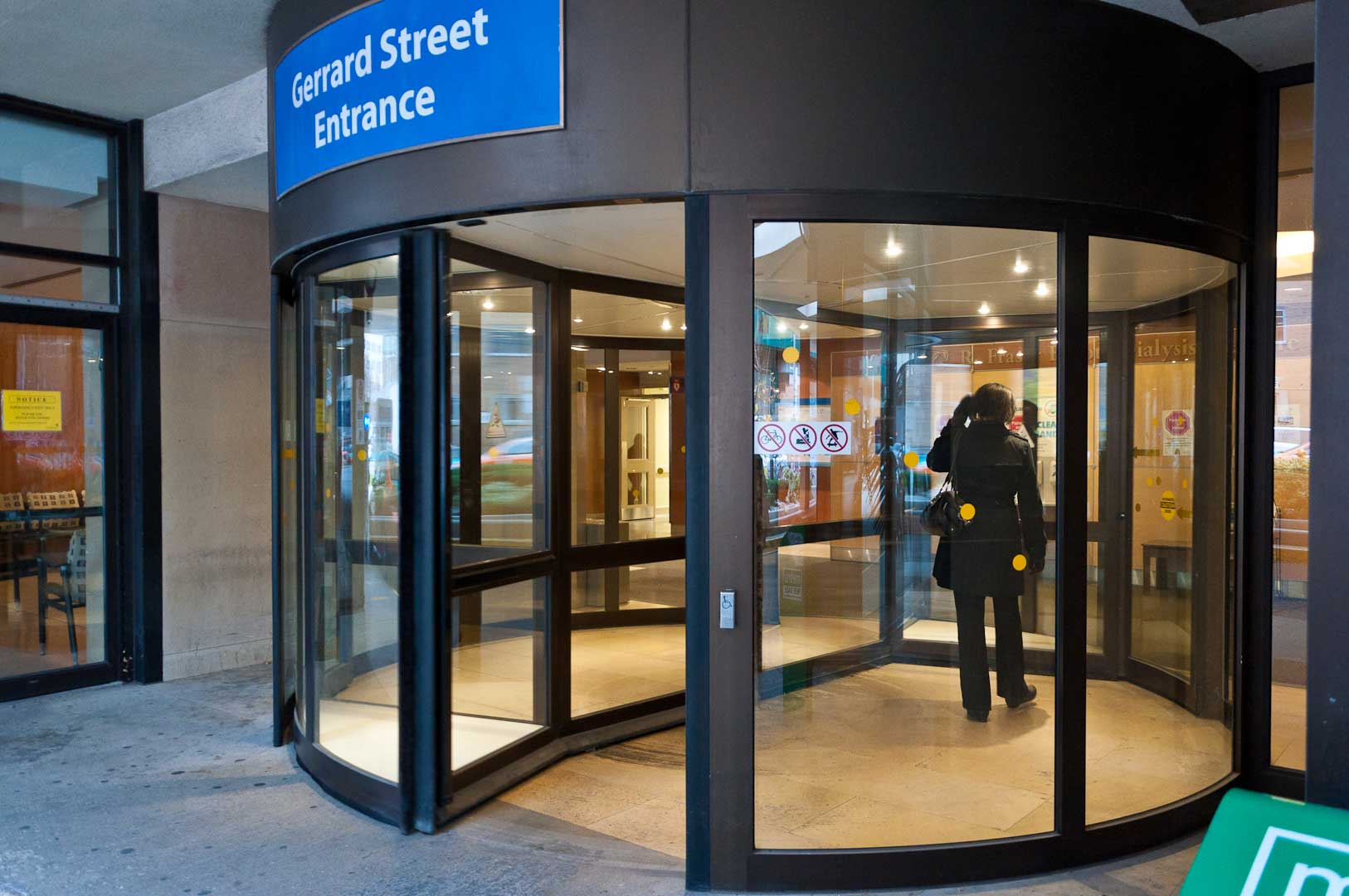 Close up of lady walking through Gerrard Street Revolving Door Maintained by Explore1.ca