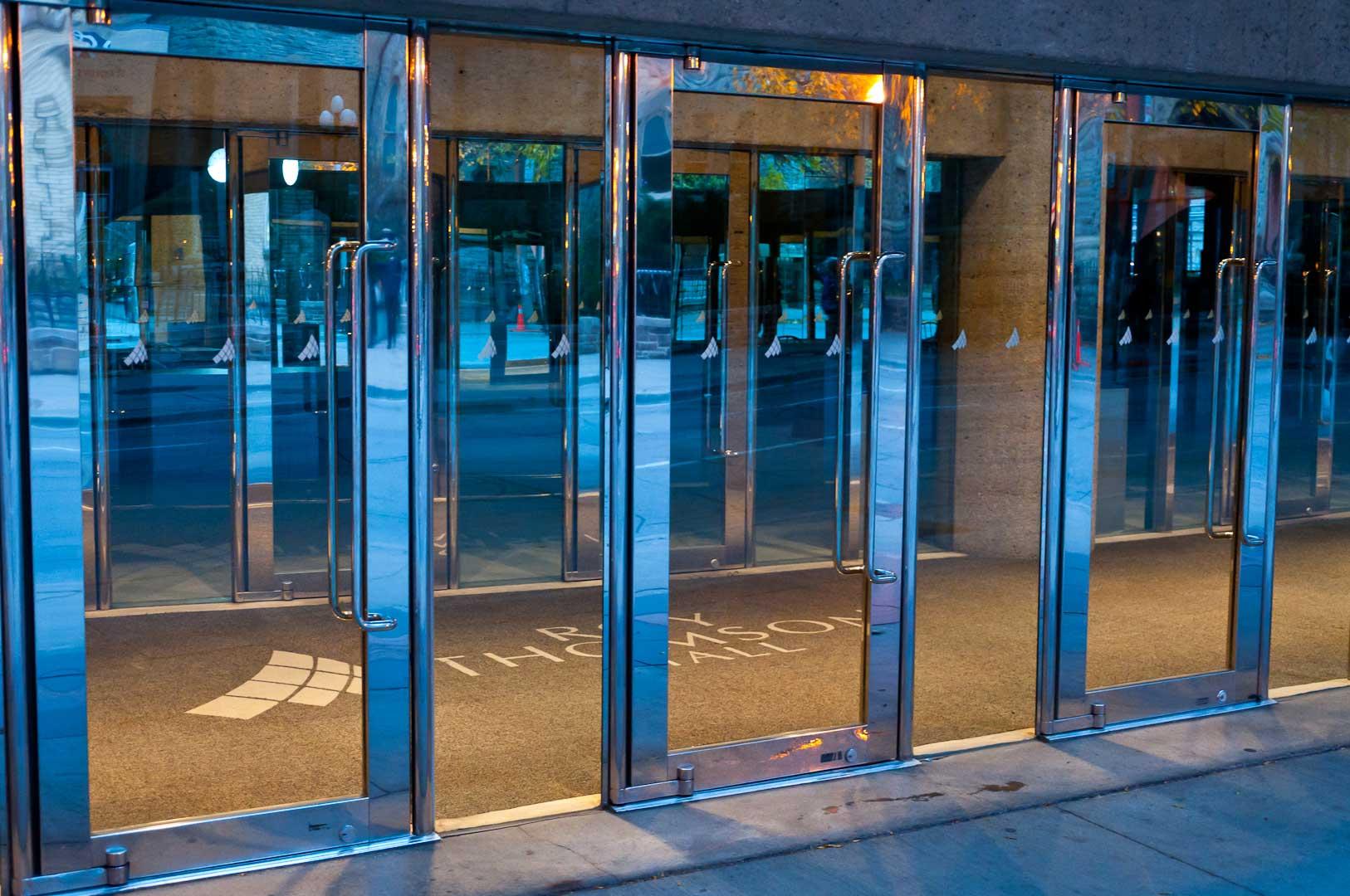 Stainless Steel and Glass Balanced Doors part of Explore1.ca Door Maintenance Program