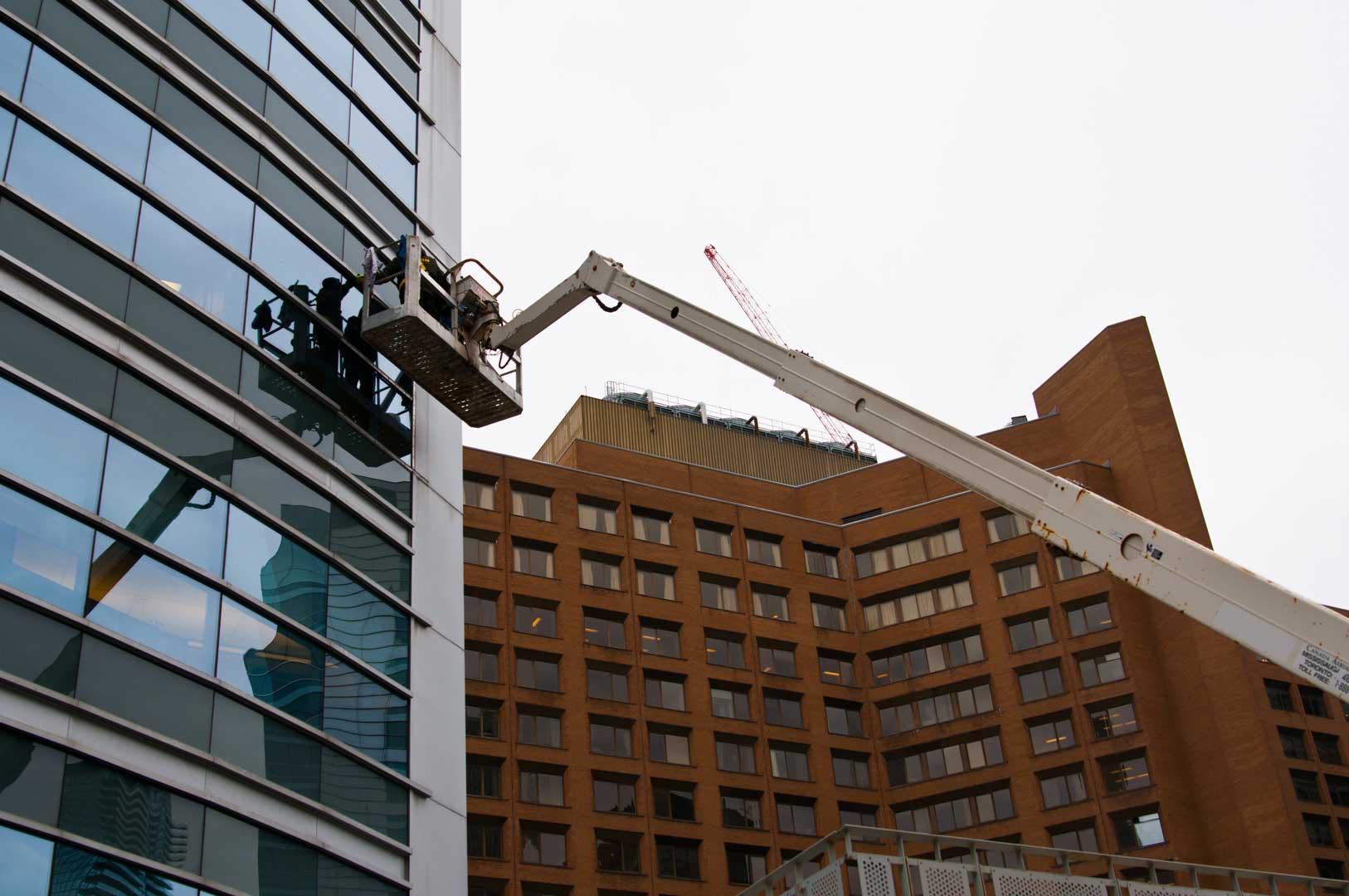 Exterior Facade Maintenance by Explore1.ca with Boom Truck in Toronto Ontario