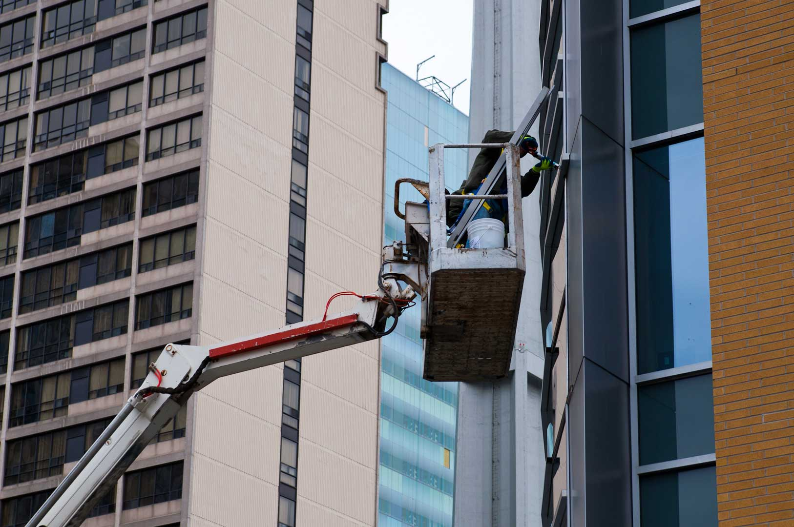 High-Rise Access by Boom Truck to Caulk Windows in the GTA with Explore1.ca