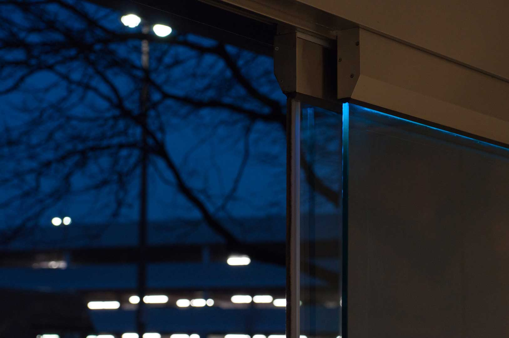 Tormax Glass Sliding Doors installed in Toronto Close-up of Blue LED lighting by Explore1.ca