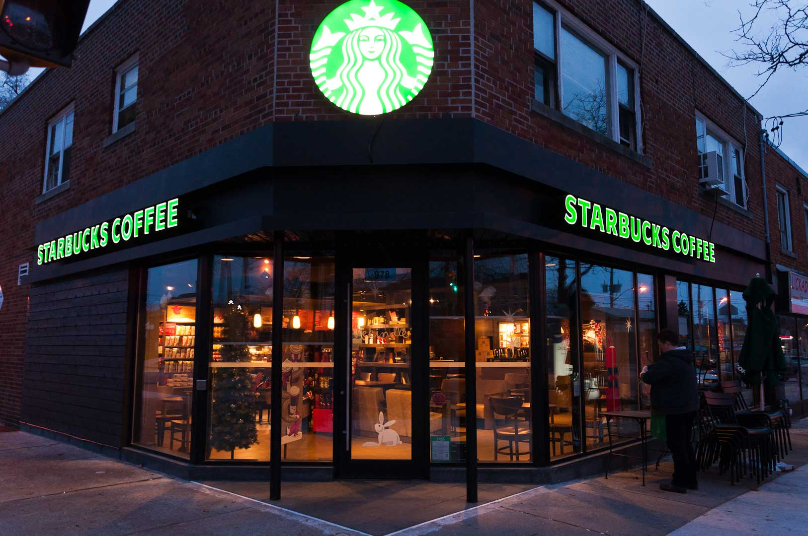 Anodized Black Storefront with Large Glass by Explore1.ca for Starbucks Toronto
