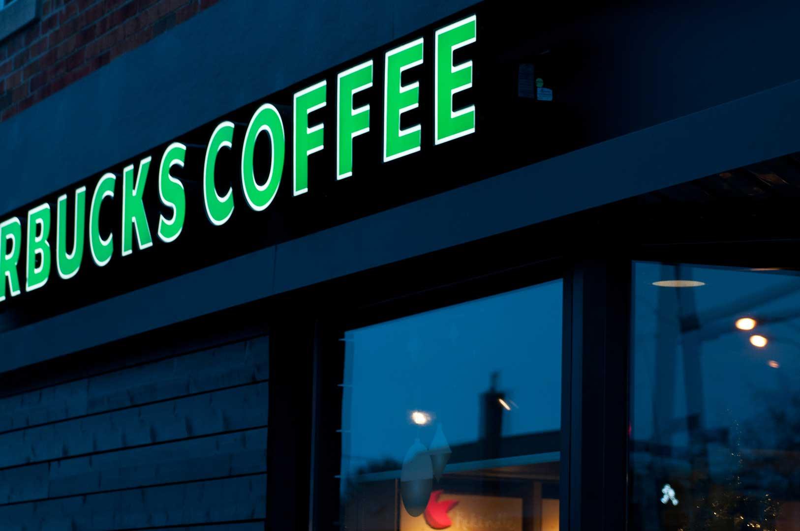 Dark Starbucks Sign Showing Metal Work by Explore1.ca